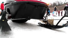 a red snow mobile on a ski resort - stock footage