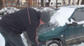 Man, Driver Remove, Cleaning Snow by Car in Parking Lot on Blizzard Snowing Day HD Footage