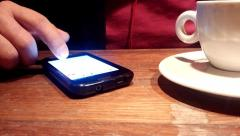 Smartphone at coffee Stock Footage
