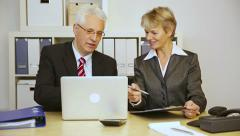 Two business people talking in office Stock Footage