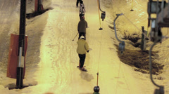 Two lanes of people skiing Stock Footage