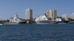 Mega yacht super yacht luxury ship LUNA and Le Grande Bleu at dock pier harbor Stock Footage