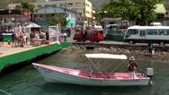 Stock Video Footage of St. Lucia sailing  031 Soufrièr, a water taxi is waiting at the pier