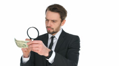 Businessman examining a banknote Stock Footage