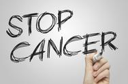 Stock Illustration of stop cancer hand written on a white board
