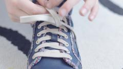 Little girl practices tying laces, tracking shot, 3 Stock Footage