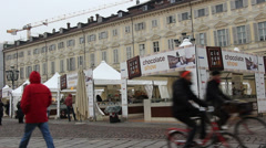 Cycling past Torino Chocolate show in Italy Stock Footage