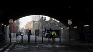 Stock Video Footage of LONDON - Man with hoodie speaks over the phone under a bridge