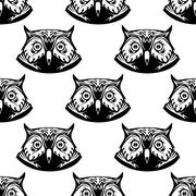 Seamless pattern of wise owl heads Stock Illustration