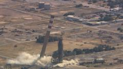Aerial shot of chimney stack blowing up Stock Footage
