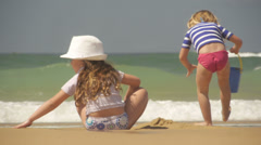 Sisters playing on beach Stock Footage