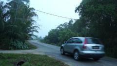 A Car Passing By On Cornering Road In Quiet Rural Area Stock Footage