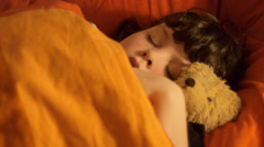 Sleeping child with teddy Stock Footage