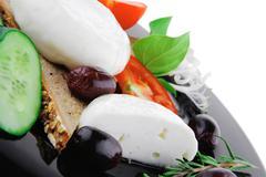 Mozzarella cheese on black dish Stock Photos