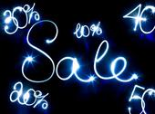 Stock Illustration of glowing inscription sale on a black