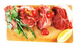 uncooked meat medallion on wood - stock photo
