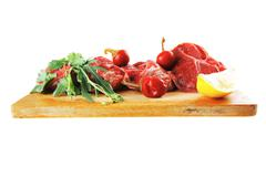 Stock Photo of raw beef medallion on wood