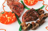 Stock Photo of roast fillet mignon with tomatoes