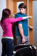 woman imploring her boyfriend from home - stock photo