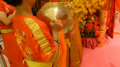 Young man playing cymbals at a lion dance performance in Chinese New Year Stock Footage