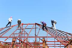 Stock Photo of labor working in construction site for roof prepare