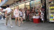 Stock Video Footage of Two Beautiful Asian Women walking down Tokyo Sidewalk in Shibuya Japan