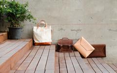 fashion leather bags on grunge background - stock photo