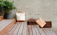 Stock Photo of fashion leather bags on grunge background