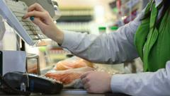 Shopping. Check out in supermarket store - stock footage