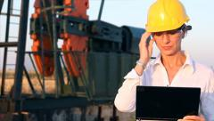 Business woman and oil pump jack Stock Footage