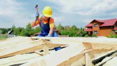 Roofer carpenter works on roof Stock Footage