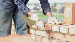 Construction mason worker bricklayer Stock Footage