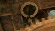 Stock Video Footage of close up wooden cogwheel and governor industrial windmill in operation