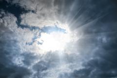 Sun in the cloudy sky Stock Photos