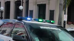 Poliisiauto vilkut San Juan kadulla HD 0604 Arkistovideo