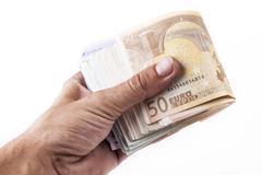 Paying euros Stock Photos