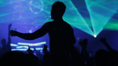 Silhouette male dancing at dance event on someones shoulders Stock Footage