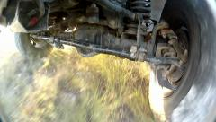Under the off-road car while it is moving fast - stock footage