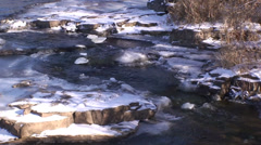 Flowing river with snow and ice. #7 Stock Footage