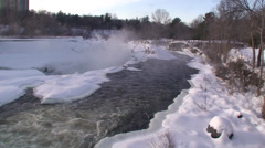Rushing waterfalls and  river with snow and ice. #9 Stock Footage