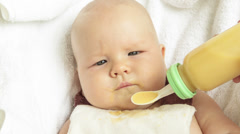 Baby Feeding With Spoon Feeder Stock Footage