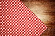 Stock Photo of table cloth, kitchen napkin on wooden background.