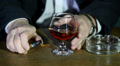 businessman with alcohol and  cigarette. Footage