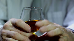 Man's hands, cognac, whisky, alcohol Stock Footage