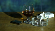 Stock Video Footage of Cognac glass, lighter and cigarettes