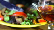 Stock Video Footage of Glass of cognac and dinner