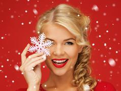 lovely woman in red dress with snowflake - stock illustration