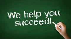 Stock Photo of we help you succeed chalk illustration