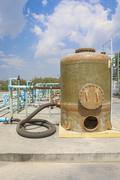 chemical tank storage with pvc pipe line - stock photo