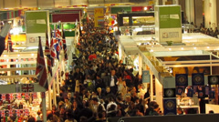 Crowd in mass exhibition fair Stock Footage